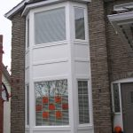 two storey Window Capping Calgary