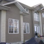 Home Exterior with new stucco installed by Legacy Exteriros