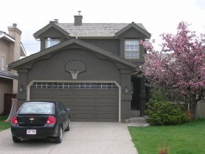 Calgary Home Stucco Repainted Dark brown